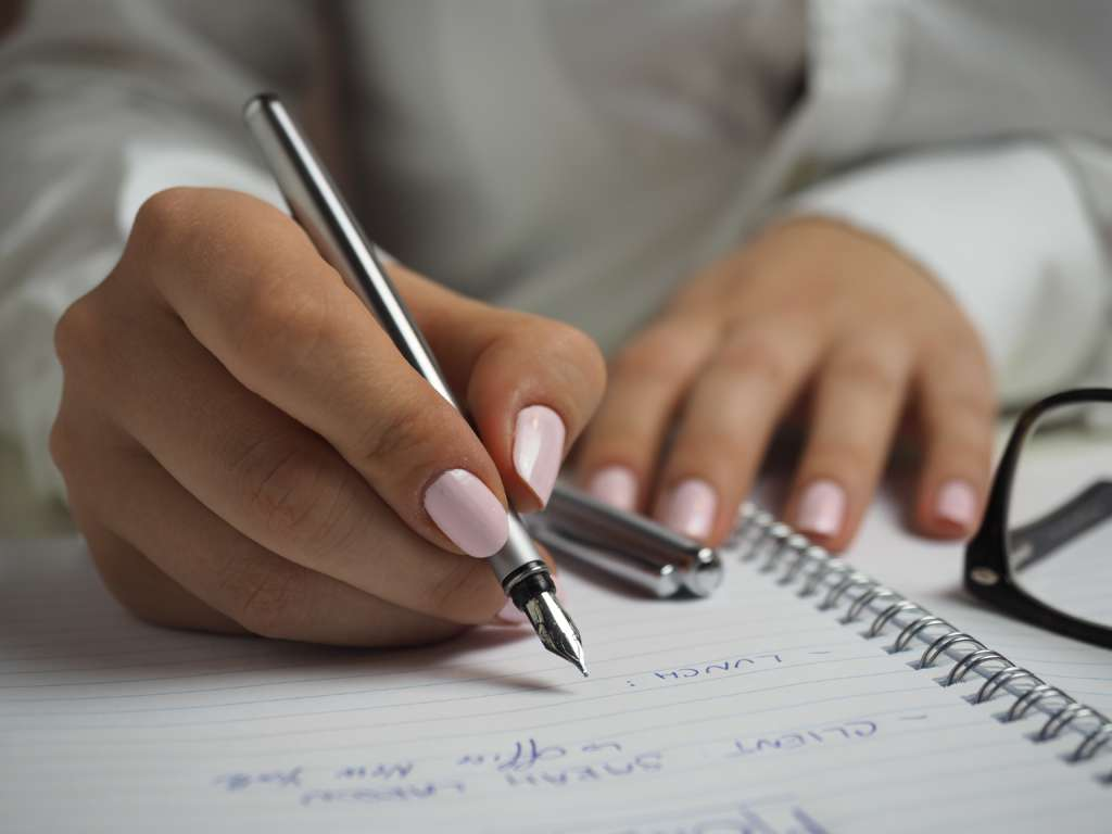 A homebuyer making a list of criteria important to them in home search